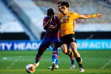 Raul Jimenez of Wolverhampton Wanderers takes on Mamadou Sakho of Crystal Palace