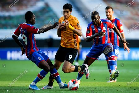 Raul Jimenez of Wolverhampton Wanderers takes on Tyrick Mitchell of Crystal Palace and Mamadou Sakho of Crystal Palace