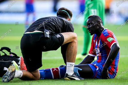Mamadou Sakho of Crystal Palace recieves treatment for an injury