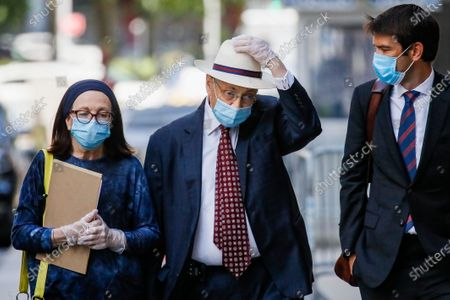 Stock Image of Former New York Assembly Speaker Sheldon Silver, center, leaves U.S. District Court after he was sentenced to 6 1/2 years in prison in the corruption case that drove him from power, in the Manhattan borough of New York. U.S. District Judge Valerie E. Caproni insisted that Silver come to court in person to hear his punishment, rather than appear remotely because of concerns about exposure to the coronavirus