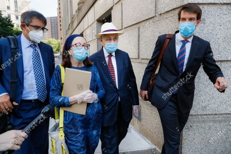 Former New York Assembly Speaker Sheldon Silver, second from right, leaves U.S. District Court after he was sentenced to 6 1/2 years in prison in the corruption case that drove him from power, in the Manhattan borough of New York. U.S. District Judge Valerie E. Caproni in Manhattan came after she insisted that the 76-year-old Democrat come to court in person to hear his punishment, rather than appear remotely because of concerns about exposure to the coronavirus