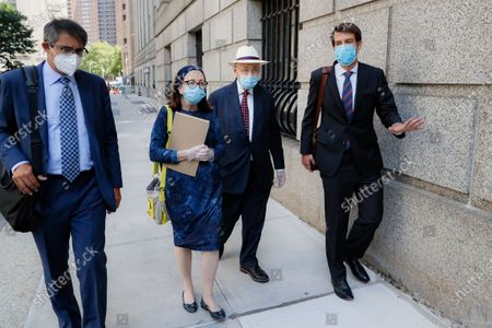 Stock Photo of Former New York Assembly Speaker Sheldon Silver, second right, leaves U.S. District Court after he was sentenced to 6 1/2 years in prison in the corruption case that drove him from power, in the Manhattan borough of New York. U.S. District Judge Valerie E. Caproni in Manhattan came after she insisted that the 76-year-old Democrat come to court in person to hear his punishment, rather than appear remotely because of concerns about exposure to the coronavirus