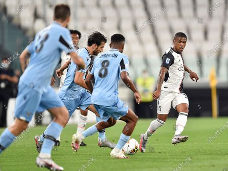 Juventus' Douglas Costa (R) in action during the Italian Serie A soccer match Juventus FC vs SS Lazio at the Allianz stadium in Turin, Italy, 20 July 2020.