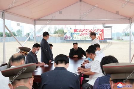 An undated photo released by the official North Korean Central News Agency (KCNA) shows North Korean leader Kim Jong Un (C, back), chairman of the Workers' Party of Korea, chairman of the State Affairs Commission of the Democratic People's Republic of Korea (DPRK) and supreme commander of the armed forces of the DPRK, giving field guidance to the Pyongyang General Hospital under construction, in Pyongyang, North Korea (issued 20 July 2020).