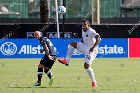 Inter Miami defender Roman Torres (29) gets control of the ball in front of New York City FC midfielder Alexandru Mitrita, left, during the first half of an MLS soccer match, in Kissimmee, Fla