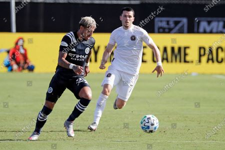 New York City FC defender Ronald Matarrita, left, moves the ball past Inter Miami midfielder Lewis Morgan during the first half of an MLS soccer match, in Kissimmee, Fla