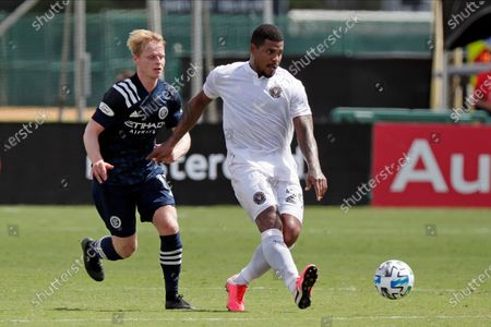 Inter Miami defender Roman Torres, right, passes the ball in front of New York City FC midfielder Gary Mackay-Steven, left, during the second half of an MLS soccer match, in Kissimmee, Fla
