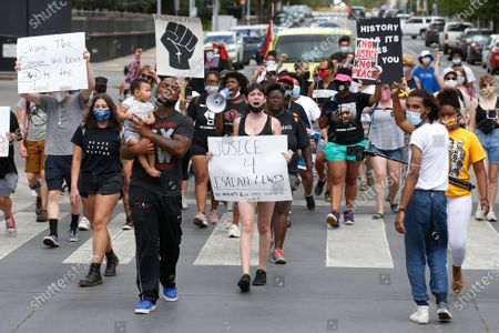 Protestors march to call for Oklahoma County District Attorney David Prater to reopen his investigation into the April 2019 shooting death of 17-year-old Isaiah Mark Lewis by police in the Oklahoma City suburb of Edmond, Okla., in Oklahoma City