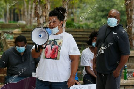 Alisha Tramble Jackson, an aunt of Isaiah Lewis, speaks at a protest, in Oklahoma City. Protestors called for call for Oklahoma County District Attorney David Prater to reopen his investigation into the April 2019 shooting death of 17-year-old Isaiah Mark Lewis by police in the Oklahoma City suburb of Edmond, Okla