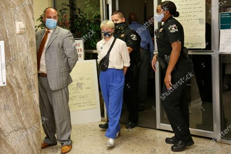 Protestors are escorted out of the office of Oklahoma County District Attorney David Prater in handcuffs at closing time, after staging a sit-in and refusing to leave, in Oklahoma City. Their demands included a call for Prater to reopen his investigation into the April 2019 shooting death of 17-year-old Isaiah Mark Lewis by police in the Oklahoma City suburb of Edmond, Okla