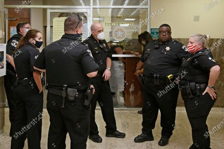 Stock Photo of Oklahoma County Sheriff's Deputies stand outside the office of Oklahoma County District Attorney David Prater as protestors conduct a sit-in at the office, in Oklahoma City. Their demands included a call for Prater to reopen his investigation into the April 2019 shooting death of 17-year-old Isaiah Mark Lewis by police in the Oklahoma City suburb of Edmond, Okla