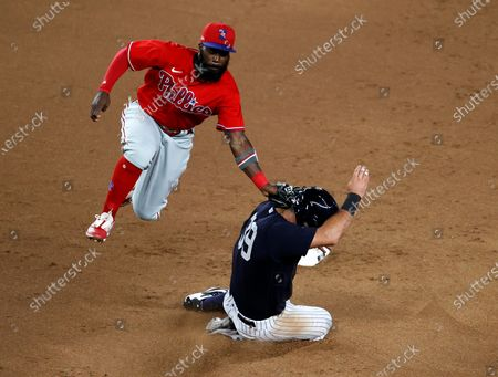 Philadelphia Phillies second baseman John Harrison (L) tags out New York Yankees center fielder Mike Tauchman (R) as she tries to steal second base during an exhibition game during summer camp before the start of the 2020 MLB season at Yankee Stadium in the Bronx, New York, USA, 20 July 2020. The start of the season was delayed due to the outbreak of the coronavirus and COVID-19 disease pandemic.