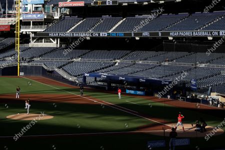 San Diego Padres starting pitcher Garrett Richards throws to Los Angeles Angels' David Fletcher during the first inning of an exhibition baseball game at Petco Park, in San Diego