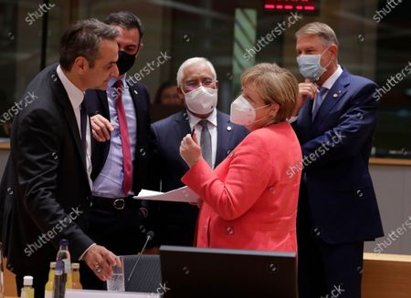 (L-R) Greece's Prime Minister Kyriakos Mitsotakis, Spanish Prime Minister Pedro Sanchez, Portuguese's Prime Minister Antonio Costa, Romania President of Klaus Werner Iohannis and Germany's Chancellor Angela Merkel participate in a last roundtable discussion following a four day European summit at the European Council in Brussels, Belgium, 21 July 2020. European Union nations leaders meet face-to-face for a fourth day to discuss plans to respond to the coronavirus pandemic and a new long-term EU budget.