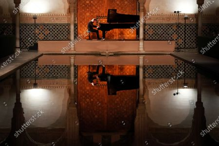 Russian pianist Igor Levit performs during a concert held at Alhambra's Arrayanes Courtyard as part of the International Music and Ballet Festival in Granada, 20 July 2020 (issued on 21 July 2020). The festival runs until 26 July.