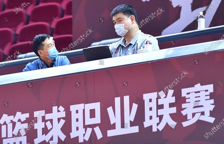Yao Ming (R), chairman of the Chinese Basketball Association, is seen during a match between Beijing Royal Fighters and Nanjing Monkey Kings at the 2019-2020 Chinese Basketball Association (CBA) league in Qingdao, east China's Shandong Province, July 21, 2020.