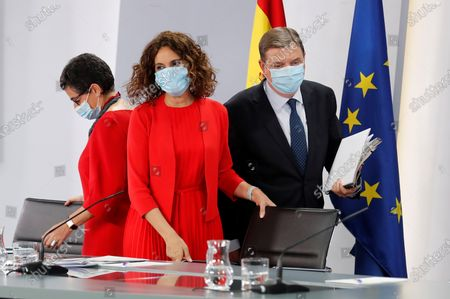 (L-R) Spanish Foreign Affairs Minister, Arancha Gonzalez Laya; Treasure Minister, Maria Jesus Montero, and Agriculture Minister, Luis Planas, arrive to address a press conference after the weekly Cabinet's meeting at La Moncloa Palace, in Madrid, Spain, 21 July 2020.