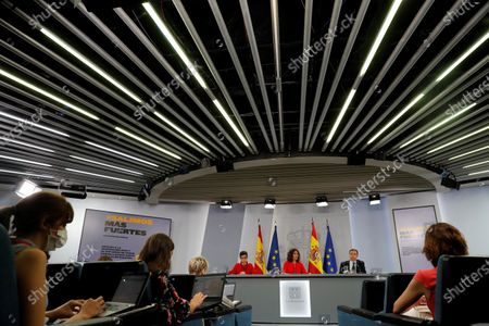 (L-R) Spanish Foreign Affairs Minister Arancha Gonzalez Laya, Treasure Minister Maria Jesus Montero and Agriculture Minister Luis Planas address a press conference after the weekly Cabinet's meeting at La Moncloa Palace, in Madrid, Spain, 21 July 2020.