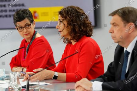 (L-R) Spanish Foreign Affairs Minister, Arancha Gonzalez Laya; Treasure Minister, Maria Jesus Montero, and Agriculture Minister, Luis Planas, address a press conference after the weekly Cabinet's meeting at La Moncloa Palace, in Madrid, Spain, 21 July 2020.