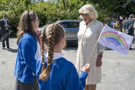 Britain's Camilla, the Duchess of Cornwall meets pupils from Treverbyn Academy primary school during a visit to Treverbyn Community Hall, in St Austell, south west England
