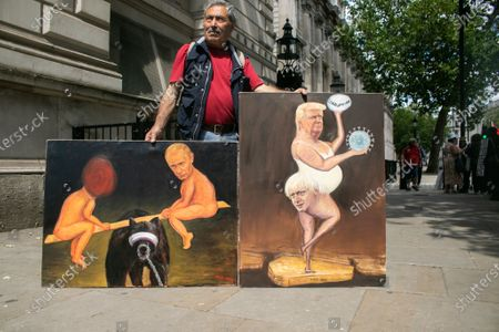 Political satirist Kaya Mar displays his paintings featuring caricatures of Prime Minister Boris Johnson and President Donald Trump during the visit of US Secretary of State Mike Pompeo