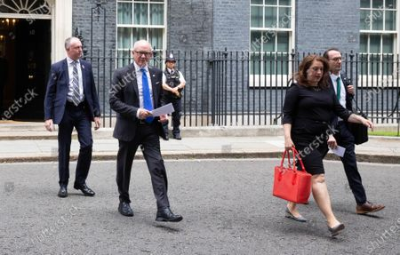 United States Ambassador to London Robert 'Woody' Johnson, ( second left), leaves 10 Downing Street.