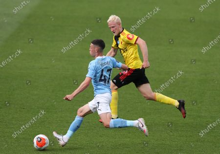 Phil Foden of Manchester City gets away from Will Hughes of Watford