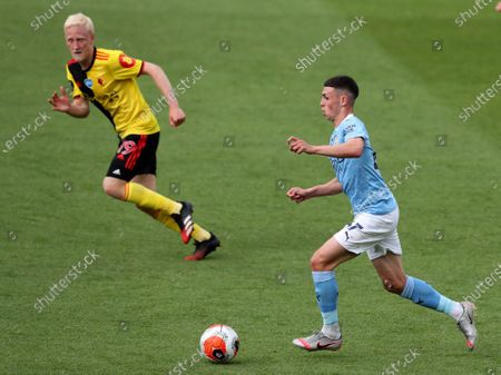 Stock Image of Phil Foden of Manchester City gets away from Will Hughes of Watford