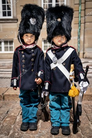 The 9-year old twin Malthe and William patrols around Amalienborg in Copenhagen, Denmakr, 21 July 2020. The twin likes to dress as the Danish Queen Margrethe's Royal Life Guards amusing visiting tourists and locals.