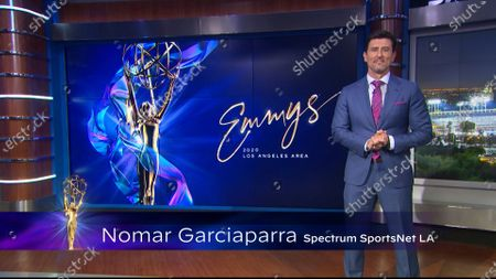 Nomar Garciaparra presents the Los Angeles Area Emmy award for Live Sports Coverage at the 2020 Los Angeles Area Emmy Awards which streamed on Emmys.com on