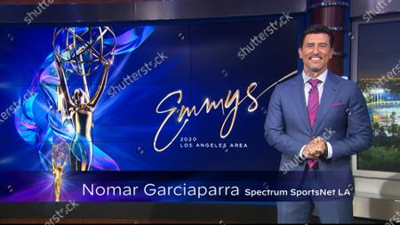 Nomar Garciaparra presents the Los Angeles Area Emmy award for Sports Feature at the 2020 Los Angeles Area Emmy Awards which streamed on Emmys.com on