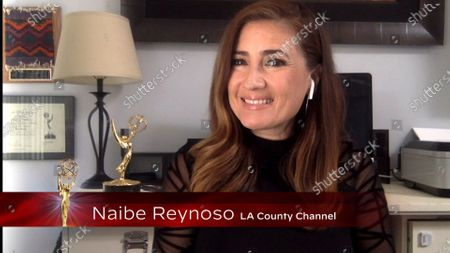 Naibe Reynoso presents the Los Angeles Area Emmy award for Information Segment at the 2020 Los Angeles Area Emmy Awards which streamed on Emmys.com on