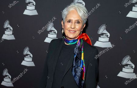 Joan Baez arrives at the Latin Grammy special merit awards, in Las Vegas. The singer, songwriter, activist and Rock and Roll Hall of Fame member is this year's recipient of the Woody Guthrie Prize, an award that recognizes artists who speak out for the less fortunate. Baez will be honored with a virtual ceremony on Aug. 16. She was inducted into the Rock and Roll Hall of Fame in 2017