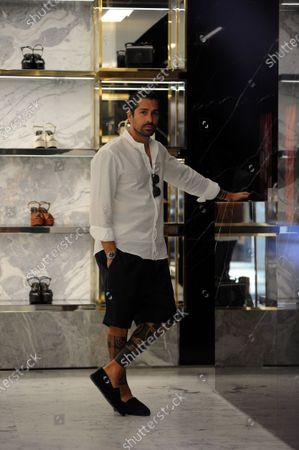 Marco Borriello shopping in Saint Laurent boutique