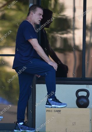 Stock Picture of Ray Liotta working out at Golds Gym