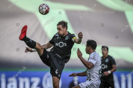 Sporting player Sebastian Coates (L) vies for the ball with Vitoria de Setubal player Mansilla (R) during the Portuguese First League soccer match Sporting vs Vitoria de Setubal held at Alvalade Stadium, in Lisbon, Portugal, 21 July 2020.