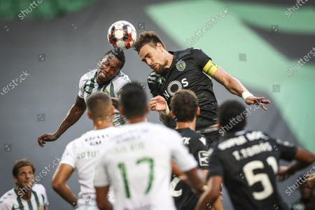 Sporting player Sebastian Coates (R) vies for the ball with Vitoria de Setubal player Semedo during the Portuguese First League soccer match Sporting vs Vitoria de Setubal held at Alvalade Stadium, in Lisbon, Portugal, 21 July 2020.