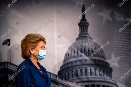 Sen. Debbie Stabenow, D-Wis., participates in a news conference on Capitol Hill in Washington