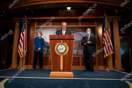 Senate Minority Leader Sen. Chuck Schumer of N.Y., center, joined by Sen. Richard Durbin, D-Ill., right and Sen. Debbie Stabenow, D-Wis., speaks during a news conference on Capitol Hill in Washington