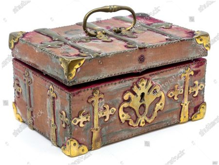 """Stock Photo of Mysterious vampire box sparks huge interest at auction - and finds a new home A mysterious vampire box containing objects reputed to ward off the monsters enshrined in European folklore attracted huge interest when it went under the hammer at Hansons Auctioneers.  Global media coverage sparked numerous enquiries and advance bids flooded in from across the world ahead of the auction. The hammer finally fell at £2,500 and the item was purchased by a private UK buyer. The lockable, velvet-covered box, lined with crimson silk, contained an oval enamel painting depicting the resurrection of Christ; carved ivory wolf in robes carrying rosary beads; percussion cap pocket pistol; cobalt blue glass phial with white metal lid (contents unknown); three clear and aqua glass bottles; rosary beads; three crucifixes; two sets of pliers; a pocket knife with mother-of-pearl handle and HM silver blade; a bottle containing shark's teeth, and a copy of The New Testament, Cambridge: J. W. Parker, 1842. Auctioneer Rik Alexander said: """"Objects like this will always fascinate the world. We have witnessed media coverage as far afield as Russia, America and China and we're delighted the item has found a new home. """"These types of boxes originated in the 1800s. They were serious kits in that period as superstition and fear were part of everyday life. All items were made with intent and every metal element had to be silver. However, this was not one of those kits."""