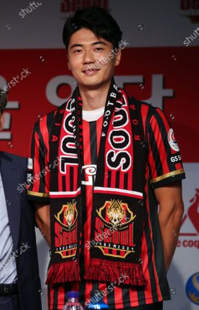 FC Seoul midfielder Ki Sung-yueng poses for photos during his introductory press conference, for rejoining the K League 1 club, at Seoul World Cup Stadium in Seoul, South Korea, 22 July 2020. FC Seoul said the midfielder is signed through 2023, but financial details will not be disclosed under a mutual agreement.
