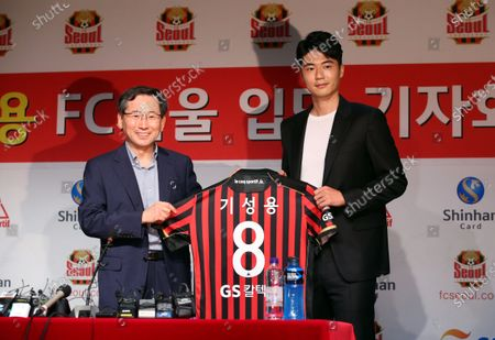 Stock Picture of FC Seoul midfielder Ki Sung-yueng (R) receives a team jersey during during his introductory press conference, for rejoining the K League 1 club, at Seoul World Cup Stadium in Seoul, South Korea, 22 July 2020. FC Seoul said the midfielder is signed through 2023, but financial details will not be disclosed under a mutual agreement.