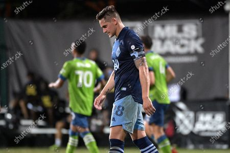 Vancouver Whitecaps defender Jake Nerwinski (28) reacts after a goal scored by Seattle Sounders forward Raul Ruidiaz during the second half of an MLS soccer match, in Kissimmee, Fla