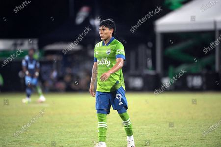 Seattle Sounders forward Raul Ruidiaz (9) sets up for a play during the second half of an MLS soccer match against the Vancouver Whitecaps, in Kissimmee, Fla