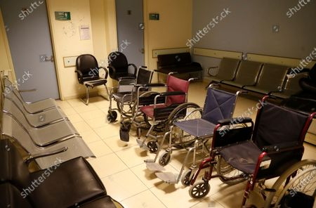 Wheelchairs sit empty at the dialysis waiting room, of a governmental hospital, in Tripoli, Lebanon, . Just as Lebanon faces a surge in coronavirus cases, hospitals are cracking under the country's financial crisis. They are struggling to pay staff, keep equipment running or even stay open amid shortages in key supplies. With dollars in short supply and the state unable to pay insurance bills, hospitals are having to turn away patients and close wards to cut costs. Public facilities, on the front line of the coronavirus fight, are too underfunded and understaffed to fill the gap