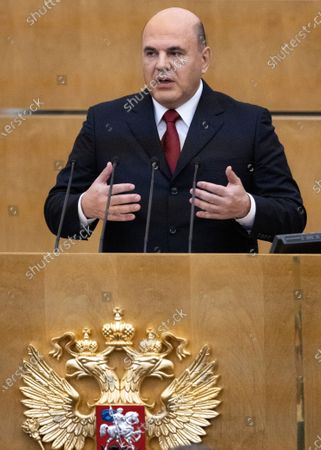 Russian Prime Minister Mikhail Mishustin gestures as he addresses the State Duma, the Lower House of the Russian Parliament, with an annual report on the country's economic and social development, in Moscow, Russia