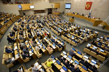 Prime Minister Mikhail Mishustin addresses the State Duma, the Lower House of the Russian Parliament from the podium with an annual report on the country's economic and social development, in Moscow, Russia