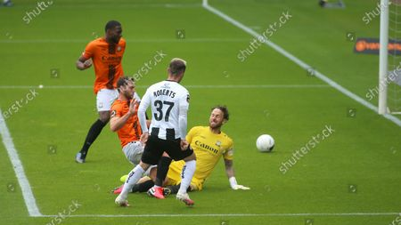 Cal Roberts slots past Scott Loach to double Notts' lead over Barnet.