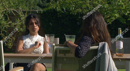 Stock Photo of Emmerdale - Ep 8816 Monday 3rd August 2020 As Sarah hands everything back, Priya Sharma's, as played by Fiona Wade, confused to see a bracelet she doesn't recognise amongst the items. She wonders why Al was keeping the bracelet a secret from her, but when Al again insists that nothing of his was taken from him by Sarah, Priya starts to suspect that he has bought it for another woman. Also pictured Manpreet Sharma, as played by Rebecca Sarker.