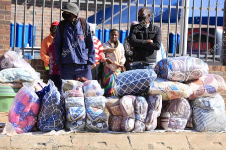 Vendors sell blankets in Mbare, Harare, Zimbabwe, 22 July 2020. As from 22 July 2020 a dusk to dawn curfew will be imposed and police will arrest anyone found between 6 pm and 6 am in new anti Coronavirus measures introduced by President Emmerson Mnangagwa. Church and political gatherings are banned but markets will be open.